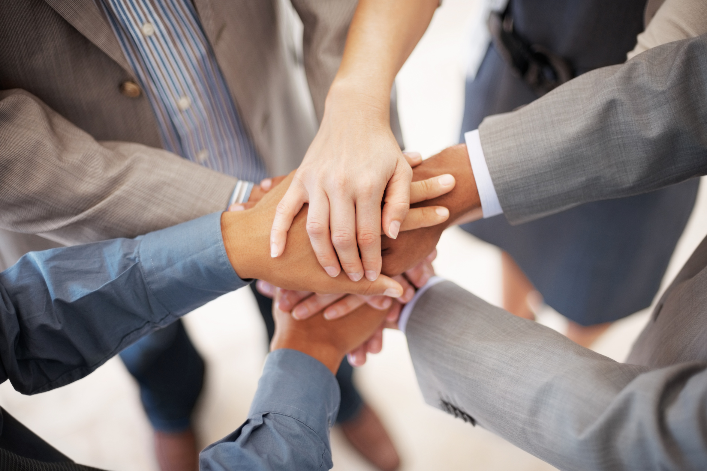 Closeup of pile of hands of business team showing unity